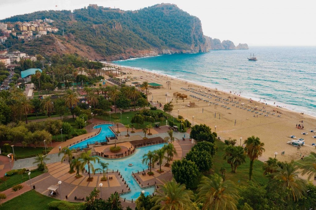 People at beach or seashore relaxing and performing leisure outdoor activities, swimming in sea Turkey, Alanya