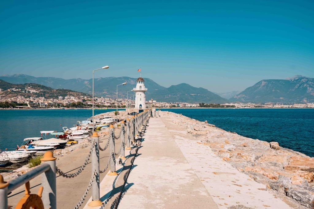Beautiful nature landscape with mountains range, blu sky and lighthouse in port Alanya, Turkey