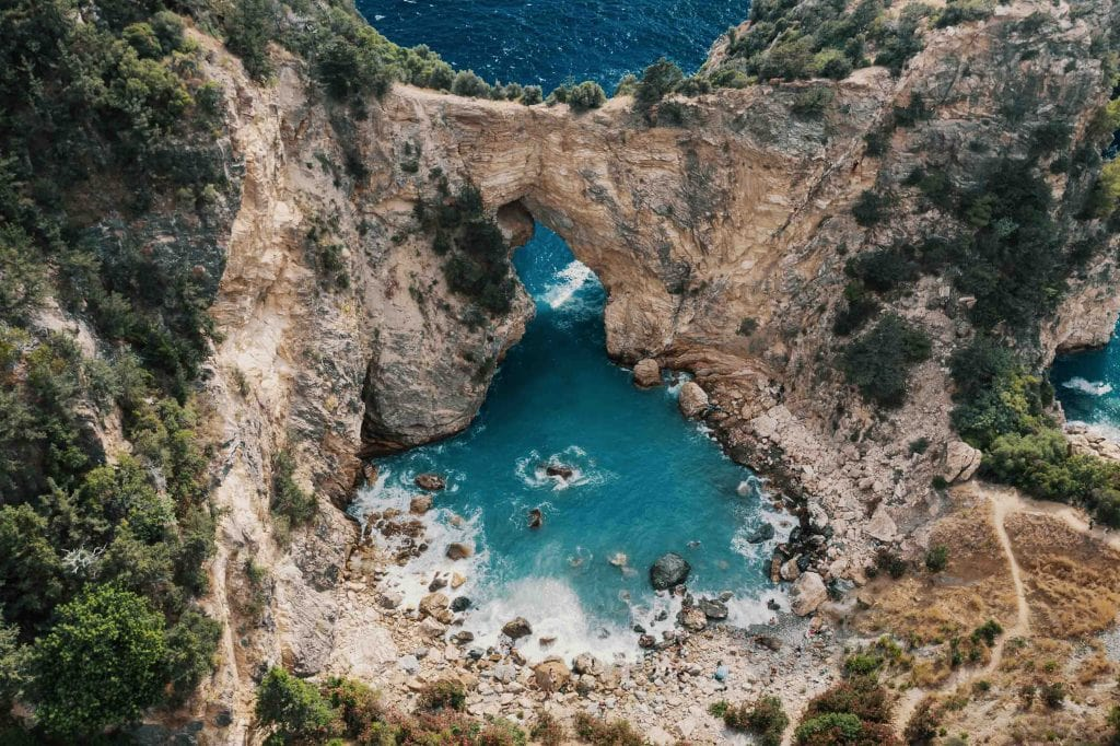 Sea Caves Turkey. The coast of the Mediterranean Sea. At the foot of Mount. Cruise over sea.